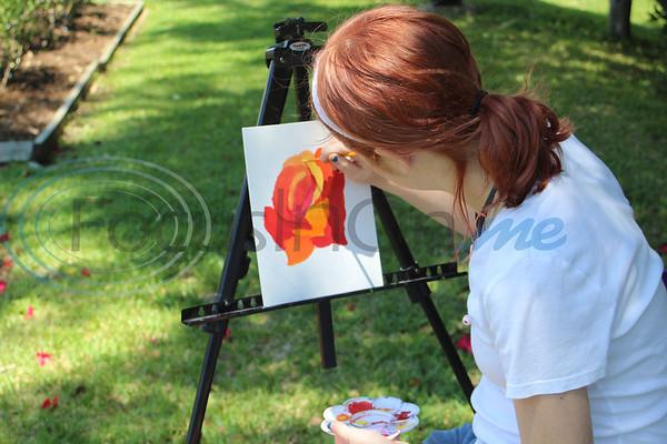 Anastasia McKay paints during the 13th Annual Art in the Garden. Sarah Perez/Freelance
