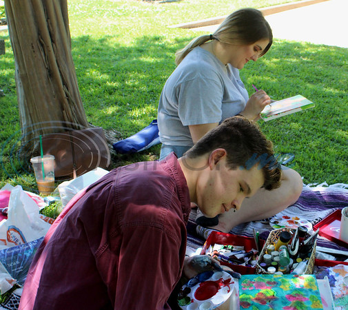 Ethan Masters and Mackenzie Guess paint during the 13th Annual Art in the Garden event at the Tyler Rose Garden. Sarah Perez/Freelance