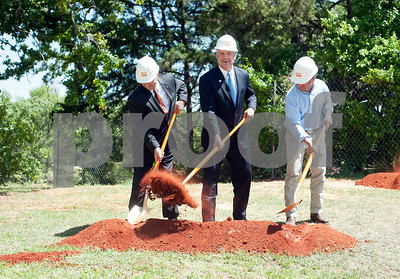 photo by Sarah A. Miller/Tyler Morning Telegraph  University of Texas at Tyler President Dr. Rodney Mabry, left, Bradley Brookshire, chairman of Brookshire Grocery Company Board of Directors, center, and Texas State Senator Kevin Eltife break ground Tuesday on the new W.T. Brookshire Hall, home of Ben and Maytee Fisch College of Pharmacy slated to open fall 2015 on the campus of the University of Texas at Tyler.