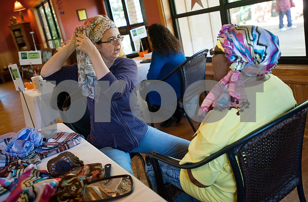 "Stacy Huddleston shows cancer survivor Linda Kennedy of Tyler how to tie a scarf during the East Texas Medical Center Cancer Institute's annual ""Great Getaway"" retreat Wednesday April 29, 2015 at Pine Cove in Flint. The retreat provides arts and crafts activities, food, dancing and more for East Texas area cancer survivors.  (photo by Sarah A. Miller/Tyler Morning Telegraph)"