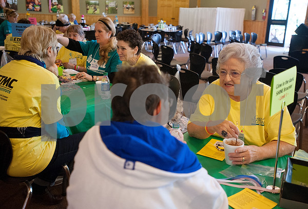 """Cancer survivor Wanda Concar of Athens, far right, talks with fellow survivor Antoinette Jackson of Bullard during the East Texas Medical Center Cancer Institute's annual """"Great Getaway"""" retreat Wednesday April 29, 2015 at Pine Cove in Flint. The retreat provides arts and crafts activities, food, dancing and more for East Texas area cancer survivors.  (photo by Sarah A. Miller/Tyler Morning Telegraph)"""