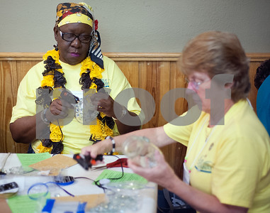 "Cancer survivors Devoria Ates of Tyler and Marilyn Hill of Longview do an arts and crafts project at the East Texas Medical Center Cancer Institute's annual ""Great Getaway"" retreat Wednesday April 29, 2015 at Pine Cove in Flint. The retreat provides arts and crafts activities, food, dancing and more for East Texas area cancer survivors.  (photo by Sarah A. Miller/Tyler Morning Telegraph)"