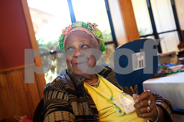 """Cancer survivor Lilie Broughton of Tyler looks in a handheld mirror at the scarf she had tied on her head during the East Texas Medical Center Cancer Institute's annual """"Great Getaway"""" retreat Wednesday April 29, 2015 at Pine Cove in Flint. The retreat provides arts and crafts activities, food, dancing and more for East Texas area cancer survivors.  (photo by Sarah A. Miller/Tyler Morning Telegraph)"""