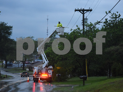 An Oncor worker works to restore power on South Street after possible tornado activity in Lindale, Texas Friday April 29, 2016.  (Sarah A. Miller/Tyler Morning Telegraph)