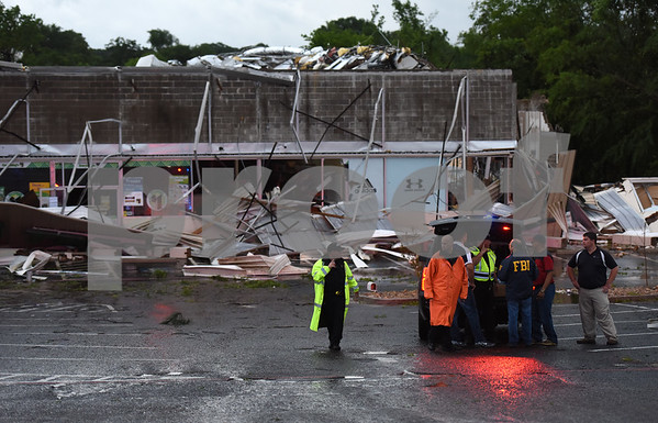The building housing the Dollar Tree and Hibbett Sports which opened last summer was damaged by possible tornado activity in Lindale, Texas Friday April 29, 2016.  (Sarah A. Miller/Tyler Morning Telegraph)