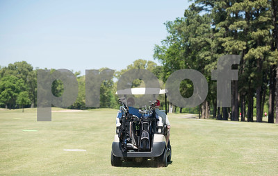 JW Gresham, 97, and his grandson Kyle Sewell ride in a golf cart during the Sharon Shriners Golf Tournament on April 7, 2017 at Pine Springs Golf Club in Tyler.  (Sarah A. Miller/Tyler Morning Telegraph)