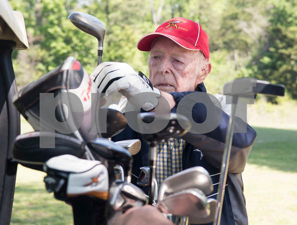 JW Gresham, 97, is picks his golf club during the Sharon Shriners Golf Tournament on April 7, 2017 at Pine Springs Golf Club in Tyler.  (Sarah A. Miller/Tyler Morning Telegraph)