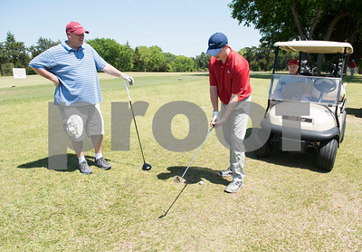 JW Gresham, 97, sits in his golf cart as his grandson Kyle Sewell and great grandson Chad Payne wait for their turn to golf during the Sharon Shriners Golf Tournament on April 7, 2017 at Pine Springs Golf Club in Tyler.  (Sarah A. Miller/Tyler Morning Telegraph)