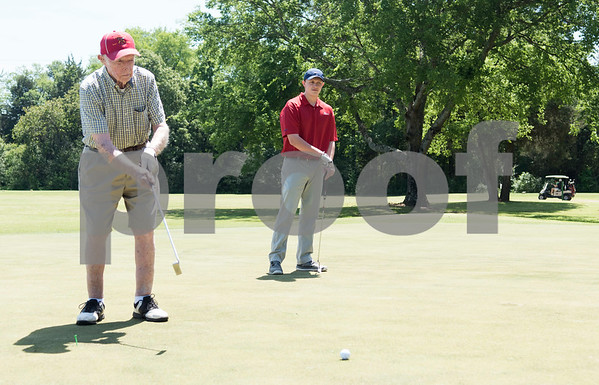 JW Gresham, 97, putts with his great grandson Chad Payne during the Sharon Shriners Golf Tournament on April 7, 2017 at Pine Springs Golf Club in Tyler.  (Sarah A. Miller/Tyler Morning Telegraph)
