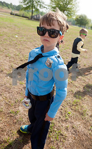 photo by Sarah A. Miller/Tyler Morning Telegraph  Jack Elementary student Sutton Smith, 6, dressed as a police officer during the school's career and community day Thursday April 9, 2015 in Tyler. The day was meant to introduce students to different careers and to help them understand the roles of community leaders such as government officials, non-profit organization leaders and public safety personnel.