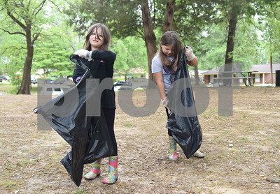 Sisters Kinley Williams, 7, and Kelsey Williams, 7, pick up litter Saturday April 9, 2016 at Southside Park. Saturday was the 30th anniversary of TxDOT's Don't Mess with Texas campaign.    (Sarah A. Miller/Tyler Morning Telegraph)