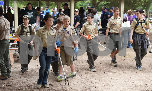 Boy Scouts head out to pick up litter Saturday April 9, 2016 at Southside Park. Saturday was the 30th anniversary of TxDOT's Don't Mess with Texas campaign.    (Sarah A. Miller/Tyler Morning Telegraph)