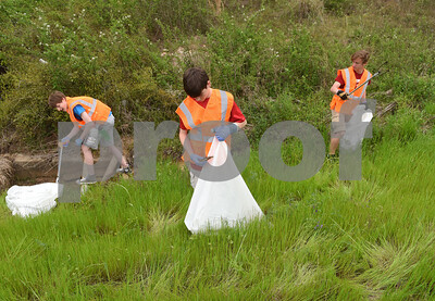 Troop 369 Boy Scouts Marshall Cameron, 17, Ken Knight, 14, and Peter Neal, 15, clean up a section of US 69N Saturday April 9, 2016. That stretch of US 69N in Tyler just north of Loop 323 was the first ever section of the Adopt-a-Highway program. Saturday was the 30th anniversary of TxDOT's Don't Mess with Texas campaign.    (Sarah A. Miller/Tyler Morning Telegraph)