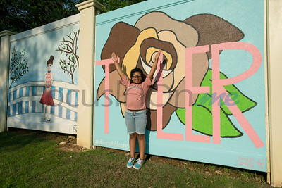 """Aamiyah Warren 10, fills in the """"Y"""" in """"Tyler"""" at the grand re-opening of Hillside Park in Tyler on Tuesday April 9, 2019. Hillside Park has undergone extensive renovations that include the installations of new sidewalks, lights, bathrooms, tables, benches, playground equipment and an art wall featuring the work of 15 local artists.   (Sarah A. Miller/Tyler Morning Telegraph)"""