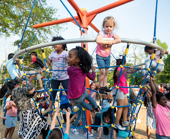 Children play at the grand re-opening of Hillside Park in Tyler on Tuesday April 9, 2019. Hillside Park has undergone extensive renovations that include the installations of new sidewalks, lights, bathrooms, tables, benches, playground equipment and an art wall featuring the work of 15 local artists.   (Sarah A. Miller/Tyler Morning Telegraph)