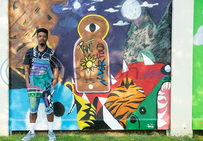 Artist Daryl Phillips stands by his mural at the grand re-opening of Hillside Park in Tyler on Tuesday April 9, 2019. Hillside Park has undergone extensive renovations that include the installations of new sidewalks, lights, bathrooms, tables, benches, playground equipment and an art wall featuring the work of 15 local artists.   (Sarah A. Miller/Tyler Morning Telegraph)