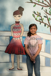 Maya Ranido, 11, stands next to the mural she painted at the grand re-opening of Hillside Park in Tyler on Tuesday April 9, 2019. Hillside Park has undergone extensive renovations that include the installations of new sidewalks, lights, bathrooms, tables, benches, playground equipment and an art wall featuring the work of 15 local artists.   (Sarah A. Miller/Tyler Morning Telegraph)