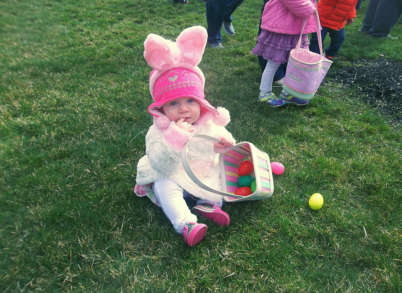 NIKKI RHOADES / GAZETTE Juliana Durken, a 1-year-old from Brunswick, is bundled up in a fuzzy coat and matching bunny ears to gather Easter eggs with mother Jennifer Durken Saturday at the Montville Township Easter Egg Hunt at Cobblestone Park.