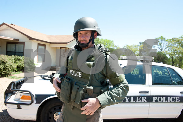 photo by Sarah A. Miller   Tyler Morning Telegraph reporter Kenneth Dean gets a first hand experience training with the Tyler Police SWAT Thursday April 11 in Tyler. The team wore their full gear and used simunition guns to complete various exercises inside of a house used for training.
