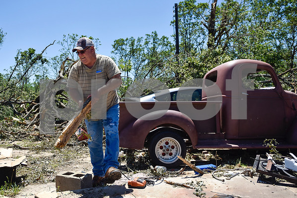 Bill Cobb picks up a piece of wood as he helps his friend Bill Cockrum's pick up after a tornado in Fruitvale, Texas, on Monday, May 1, 2017. Four confirmed tornadoes ranging from EF-0 to EF-3 touched down in Northeast Texas April 29, causing widespread damage and power outages. (Chelsea Purgahn/Tyler Morning Telegraph)