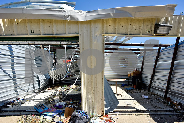 A storage unit that lost its roof during a tornado Saturday in Canton, Texas, on Monday, May 1, 2017. Four confirmed tornadoes ranging from EF-0 to EF-3 touched down in Northeast Texas April 29, causing widespread damage and power outages. (Chelsea Purgahn/Tyler Morning Telegraph)