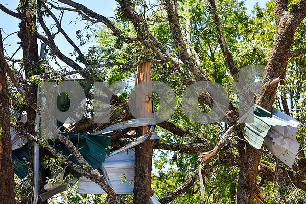 Sheet metal is intertwined in trees on the Cockrum family's property in Fruitvale, Texas, on Monday, May 1, 2017. Four confirmed tornadoes ranging from EF-0 to EF-3 touched down in Northeast Texas April 29, causing widespread damage and power outages. (Chelsea Purgahn/Tyler Morning Telegraph)