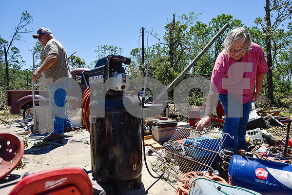Bill and Glenda Cobb help pick up tools, shelves and other items that were once in their friend Bill Cockrum's shop in Fruitvale, Texas, on Monday, May 1, 2017. Four confirmed tornadoes ranging from EF-0 to EF-3 touched down in Northeast Texas April 29, causing widespread damage and power outages. (Chelsea Purgahn/Tyler Morning Telegraph)