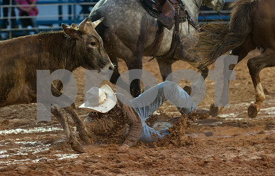Justin Shaffer of Hallsville slips in the mud during the steer wrestle competition at the I-20 Team Real Estate Lindale Championship Rodeo presented by Ram Rodeo  Thursday night. The rain stopped just in time for the rodeo to start. The rodeo continues Friday and Saturday with gates opening at 6 p.m.    (photo by Sarah A. Miller/Tyler Morning Telegraph)