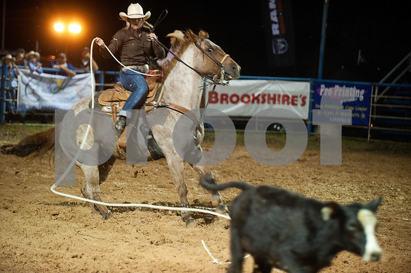 Paige Connelly competes calf roping at the I-20 Team Real Estate Lindale Championship Rodeo presented by Ram Rodeo  Thursday night. The rain stopped just in time for the rodeo to start. The rodeo continues Friday and Saturday with gates opening at 6 p.m.    (photo by Sarah A. Miller/Tyler Morning Telegraph)