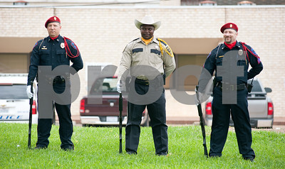 photo by Sarah A. Miller/Tyler Morning Telegraph  Henderson police officer Matthew Bammel, left, Rusky County Sheriffs officer Joseph Ervin, center, and Henderson police officer Jarrod Finley, right, stand as part of the 21 guns salute multi-agency honor guard Wednesday at the ninth annual Rusk County Ceremony Commemorating National Law Enforcement Memorial Day outside of the Rusk County Courthouse in Henderson.