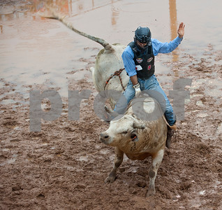 Boss Votaw of Porter rides a bull during the Tops in Texas Rodeo Friday night. The Tops in Texas Rodeo continues with their final performance Saturday night at 7 p.m. in Jacksonville.   (photo by Sarah A. Miller/Tyler Morning Telegraph)