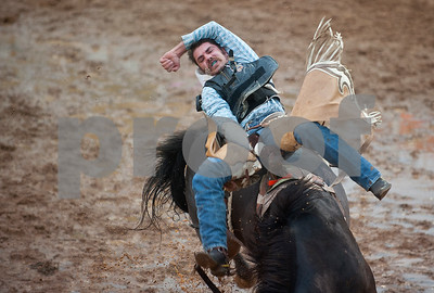 Ethan Assmann of Alta, Iowa competes in bareback riding during the Tops in Texas Rodeo Friday night. The Tops in Texas Rodeo continues with their final performance Saturday night at 7 p.m. in Jacksonville.   (photo by Sarah A. Miller/Tyler Morning Telegraph)
