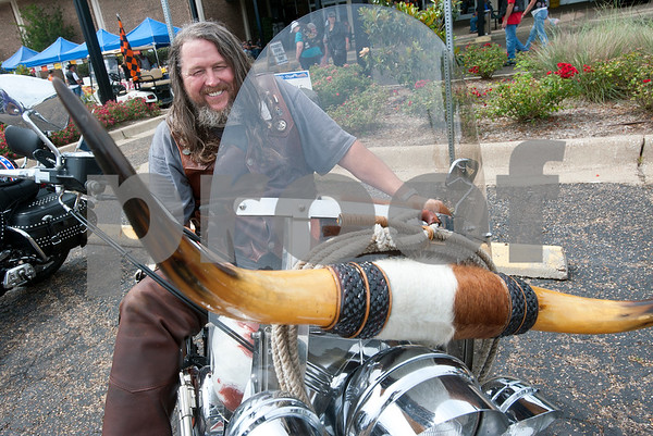 Matthew Powell of Bedford shows off his custom designed Texas themed motorcycle during the 2015 Texas State Harley Owners Group Rally held at Harvey Convention Center in Tyler Friday. The rally continues Saturday with guided rides, a parade, games, bike show and more.  (photo by Sarah A. Miller/Tyler Morning Telegraph)