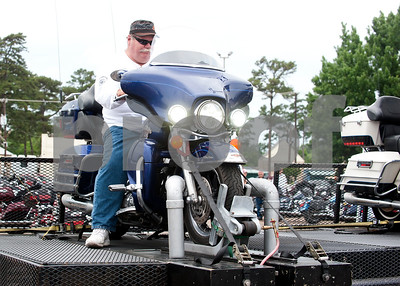 John Poole of Fort Worth competes in a simulated drag race during the 2015 Texas State Harley Owners Group Rally held at Harvey Convention Center in Tyler Friday. The rally continues Saturday with guided rides, a parade, games, bike show and more.  (photo by Sarah A. Miller/Tyler Morning Telegraph)