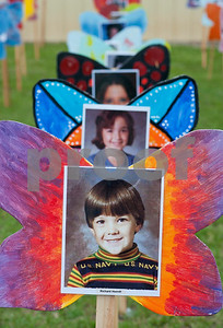 Photos of children who have passed away are displayed on wooden butterflies before the Compassionate Friends Butterfly Release Saturday. Butterflies were released in memory children who have died at any age at the Compassionate Friends Butterfly Release Saturday, May 16, 2015 at the Sharon Shrine Temple, 10027 State Highway 31 East in Tyler.  (photo by Sarah A. Miller/Tyler Morning Telegraph)