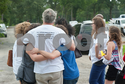 Family members of Seth Porter and Daniel Thomas Khirallah embrace after the Compassionate Friends Butterfly Release Saturday. Butterflies were released in memory children who have died at any age at the Compassionate Friends Butterfly Release Saturday, May 16, 2015 at the Sharon Shrine Temple, 10027 State Highway 31 East in Tyler.  (photo by Sarah A. Miller/Tyler Morning Telegraph)