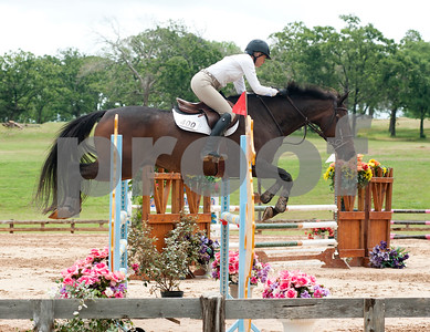 photo by Sarah A. Miller/Tyler Morning Telegraph  Ann Skogerboe of Longview rides horse Colin Taylor in the 15 meter jumper division at the Show Jumping Classic Thursday at Texas Rose Horse Park in Tyler. The hunter/jumper show continues through May 19, and the Southwest Classic will be held May 22-26 at Texas Rose Horse Park. Competitors in the jumper competition must complete a specific amount of jumps in a particular order on a timed course. Hunters are also scored on their ability to jump obstacles, but they are also judged in their style of jumping, manners, pace and beauty.