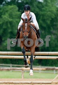 photo by Sarah A. Miller/Tyler Morning Telegraph  Ciara Murphy of The Woodlands warms up her horse Romo to compete in the Show Jumping Classic Thursday at Texas Rose Horse Park in Tyler. The hunter/jumper show continues through May 19, and the Southwest Classic will be held May 22-26 at Texas Rose Horse Park.