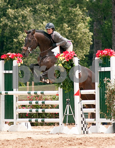 photo by Sarah A. Miller/Tyler Morning Telegraph  Gianna Aycock of Dallas rides Commissario in the 15 meter jumper division at the Show Jumping Classic Thursday at Texas Rose Horse Park in Tyler. The hunter/jumper show continues through May 19, and the Southwest Classic will be held May 22-26 at Texas Rose Horse Park. Competitors in the jumper competition must complete a specific amount of jumps in a particular order on a timed course. Hunters are also scored on their ability to jump obstacles, but they are also judged in their style of jumping, manners, pace and beauty.