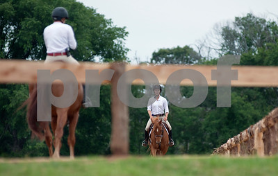 photo by Sarah A. Miller/Tyler Morning Telegraph  Competitors warm up before competing at the Show Jumping Classic Thursday at Texas Rose Horse Park in Tyler. The hunter/jumper show continues through May 19, and the Southwest Classic will be held May 22-26 at Texas Rose Horse Park. Competitors in the jumper competition must complete a specific amount of jumps in a particular order on a timed course. Hunters are also scored on their ability to jump obstacles, but they are also judged in their style of jumping, manners, pace and beauty.