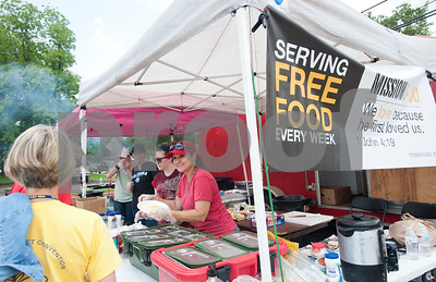 Volunteer Laura Darcy of Fruitvale takes orders for free food at the Mission U-Too tent in the parking lot of First Baptist Church in Van Thursday May 15, 2015. The church and its parking lot have become the main gathering spot for volunteers and town residents seeking shelter after the weekend tornado.    (photo by Sarah A. Miller/Tyler Morning Telegraph)