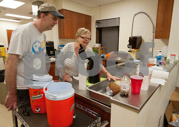 First Baptist Church in Van pastor Tom Campbell and volunteer Shanda Bulmon of Van prepare coffee in the kitchen Thursday May 15, 2015. The church and its parking lot have become the main gathering spot for volunteers and town residents seeking shelter after the weekend tornado.    (photo by Sarah A. Miller/Tyler Morning Telegraph)