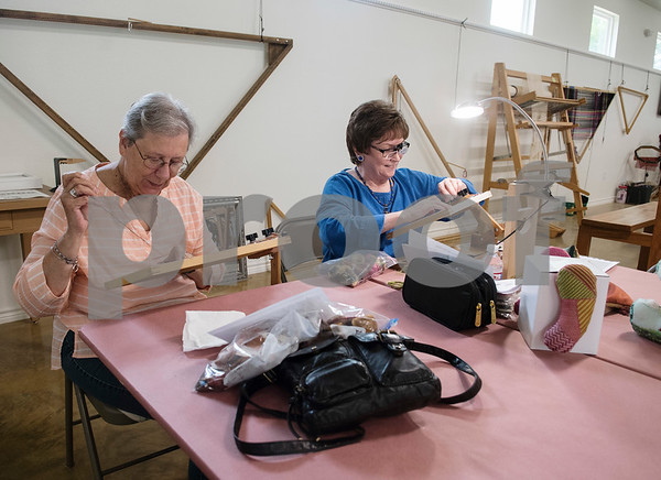 Els Korevec and Sheila Wyze work on needlepoint projects at the Mineola League of the Arts Wednesday May 10, 2017. The center has a new fiber arts building were people can learn the art of weaving and other fiber arts.   (Sarah A. Miller/Tyler Morning Telegraph)
