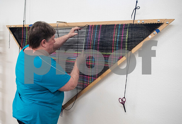 Vickie Steeds weaves a shawl on a triangle loom at the Mineola League of the Arts Wednesday May 10, 2017. The center has a new fiber arts building were people can learn the art of weaving and other fiber arts.   (Sarah A. Miller/Tyler Morning Telegraph)