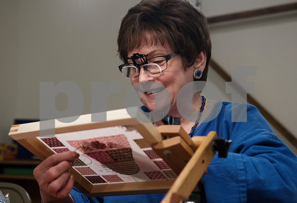 Sheila Wyze works on a needlepoint project at the Mineola League of the Arts Wednesday May 10, 2017. The center has a new fiber arts building were people can learn the art of weaving and other fiber arts.   (Sarah A. Miller/Tyler Morning Telegraph)