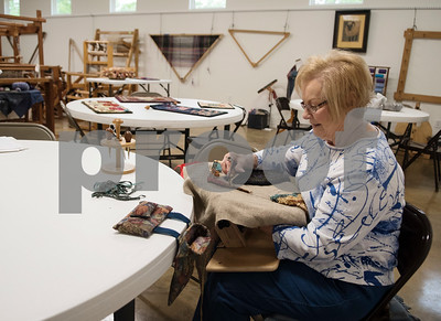 Nancy Huntley of Mineola works on her rug hooking project at the Mineola League of the Arts Wednesday May 10, 2017. The center has a new fiber arts building were people can learn the art of weaving and other fiber arts.   (Sarah A. Miller/Tyler Morning Telegraph)