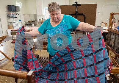 Vickie Steeds shows her woven rug at the Mineola League of the Arts Wednesday May 10, 2017. The center has a new fiber arts building were people can learn the art of weaving and other fiber arts.   (Sarah A. Miller/Tyler Morning Telegraph)