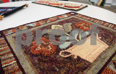 Finished rug hooking projects pictured at the Mineola League of the Arts Wednesday May 10, 2017. The center has a new fiber arts building were people can learn the art of weaving and other fiber arts.   (Sarah A. Miller/Tyler Morning Telegraph)