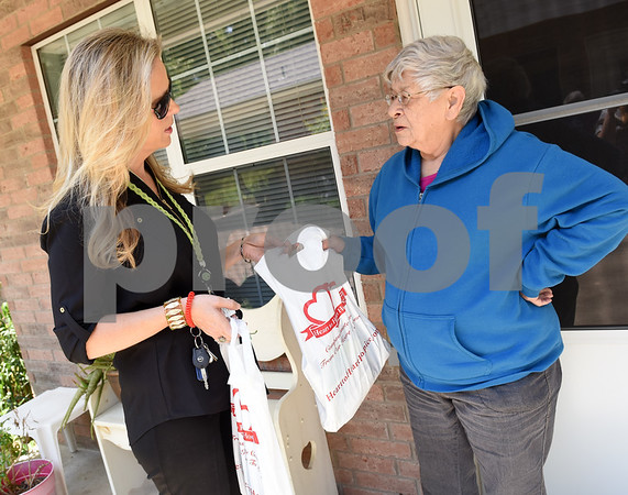 Sharon Brown, vice president of The Smith County Adult Protective Services Board, gives an informational packet on recognizing and reporting elder abuse to Lindale resident Mildred Holub Friday May 6, 2016. Brown's stop was part of a door-to-door campaign through The Smith County Adult Protective Services Board. May is Elder Abuse Awareness Month.   (Sarah A. Miller/Tyler Morning Telegraph)