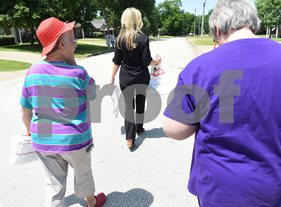 Sharon Brown, center, vice president of The Smith County Adult Protective Services Board, Legends of Lindale resident Cecil Safran, left, and Legends of Lindale manager Sue North, right, go on a door-to-door campaign handing out information about elder abuse. May is Elder Abuse Awareness Month.   (Sarah A. Miller/Tyler Morning Telegraph)